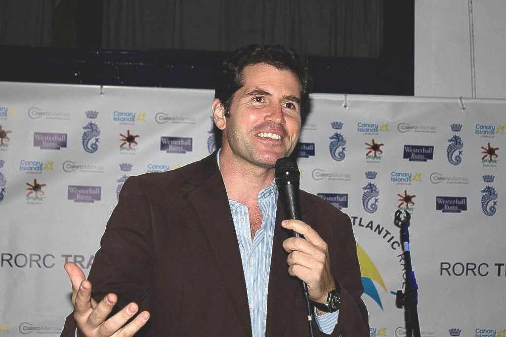 José Juan Calero speaking with a microphone at an event.