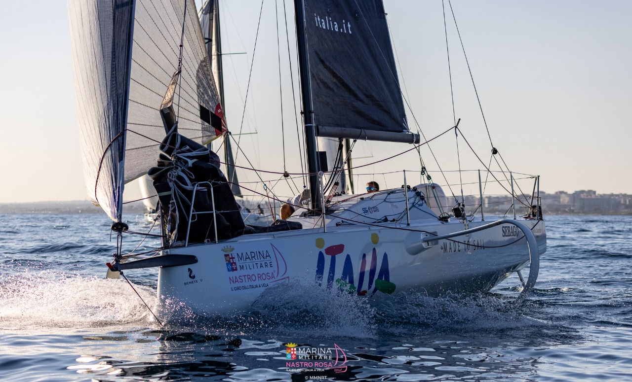 Italian boat reaching in flat water