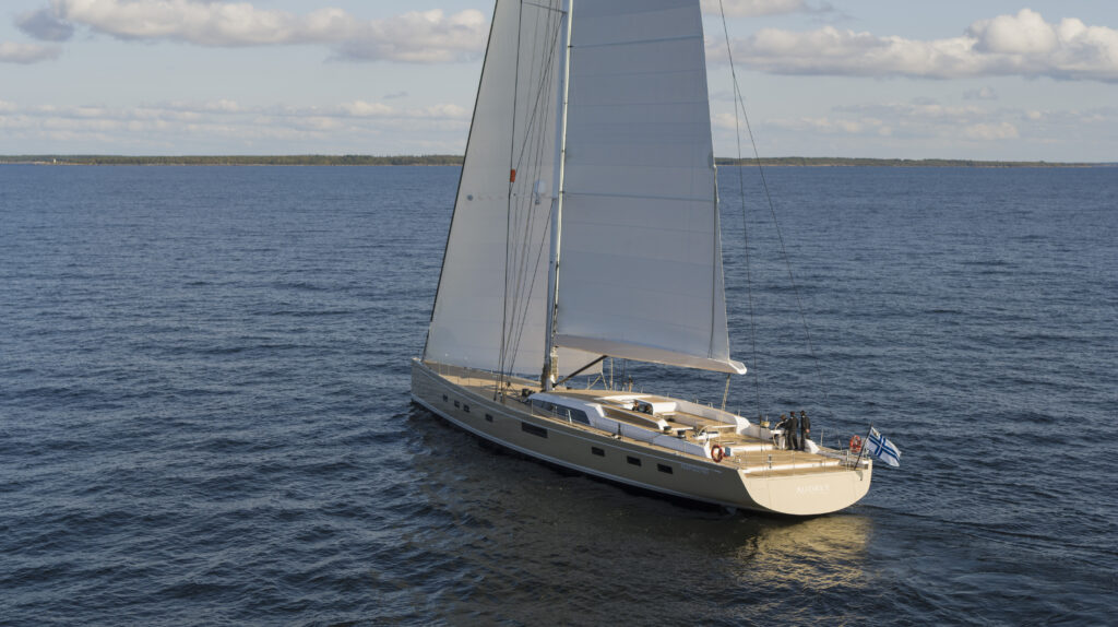 The Swan 120 sailing, brown-bronze hull colour.