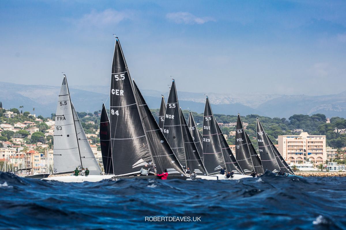 Fleet sailing upwind after race start.