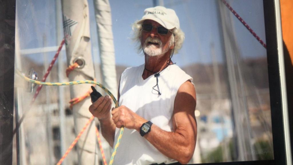 Pasquale De Gregorio on a boat on a dock, holding ropes.