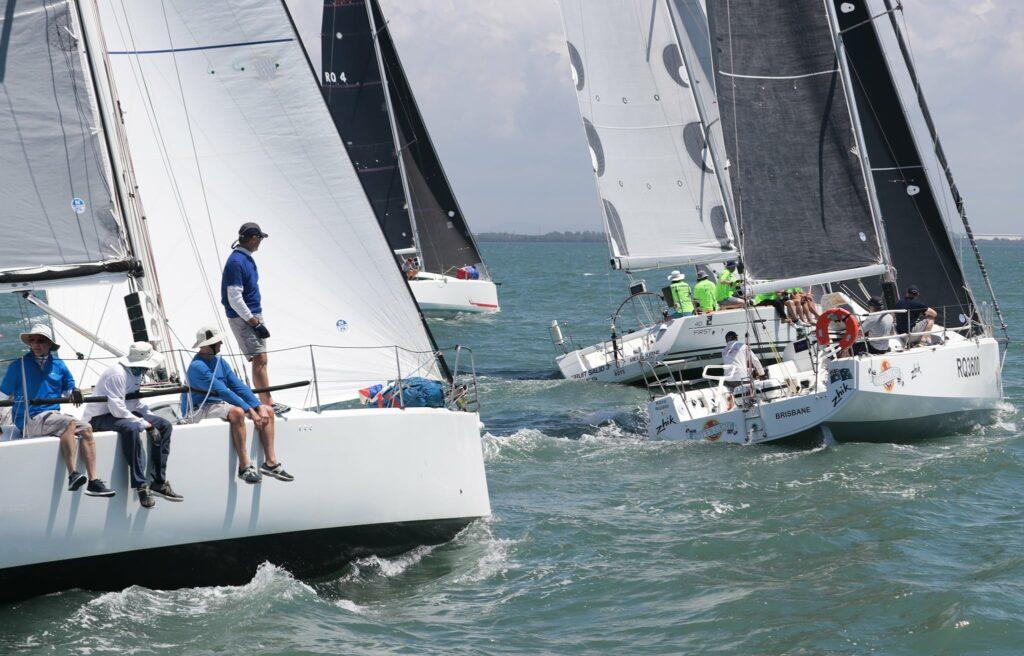Beneteau fleet sailing upwind.