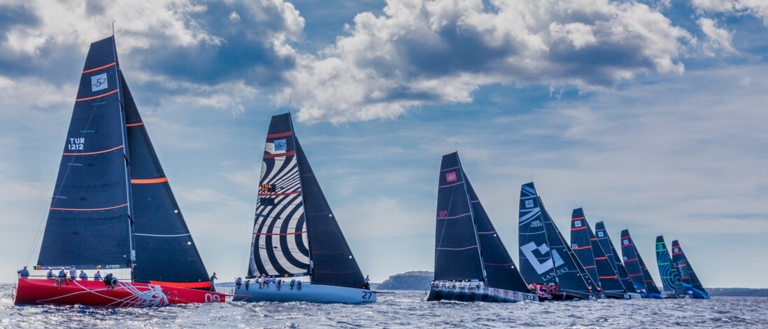 Fleet after a race start sailing upwind.