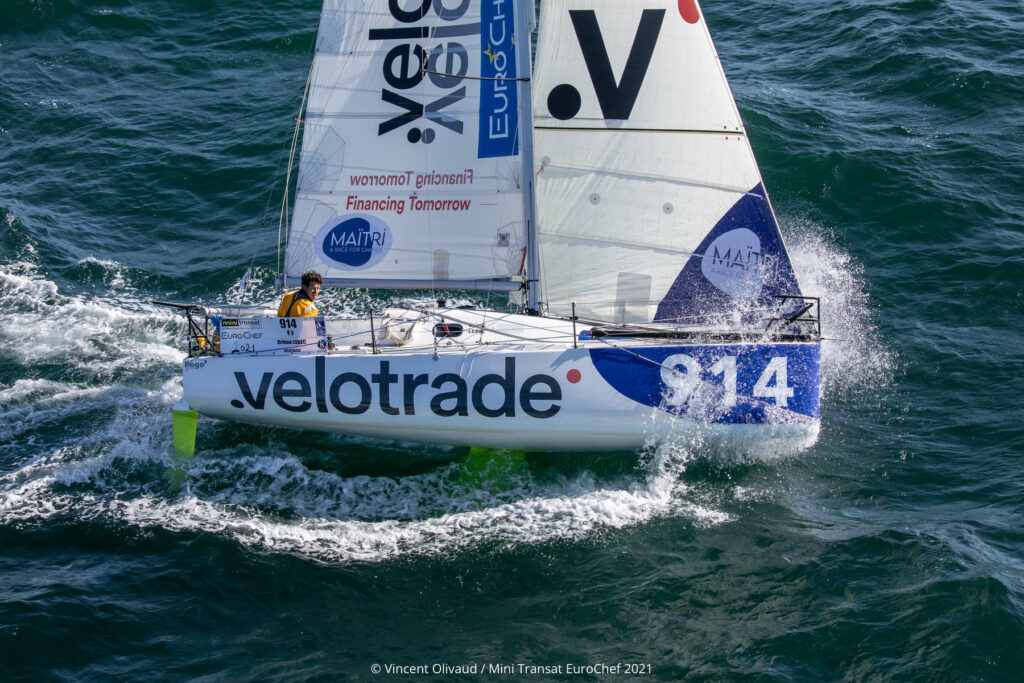 Aerial shot of Brieuc Lebec (914 – Velotrade) sailing upwind through a little bit of chop.