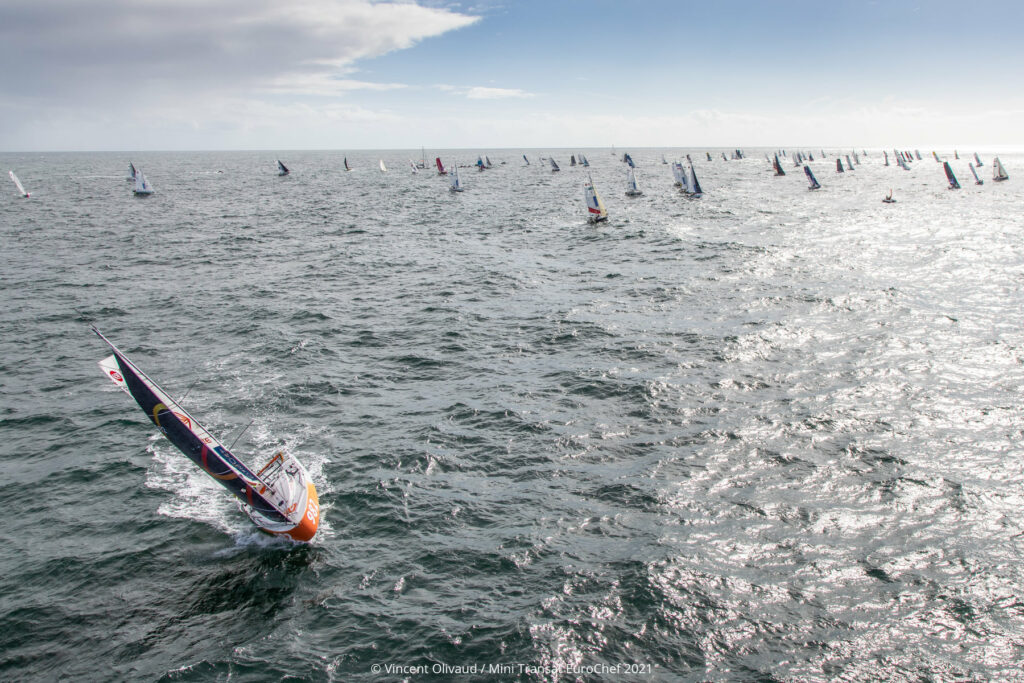 Aieral shot of fleet of Mini 6.50s sailing upwind