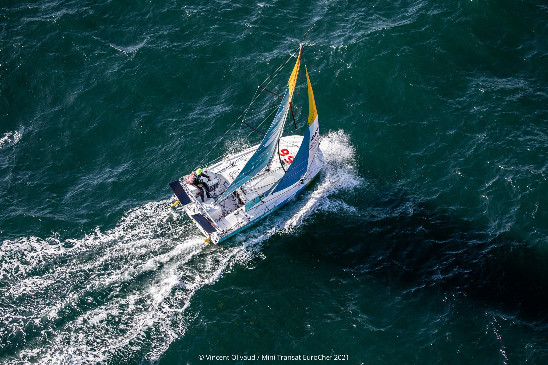 Aerial shot of a boat sailing.