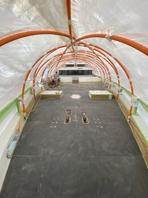 Inside Oceana. Black floor in construction. Plastic, temporary roof.