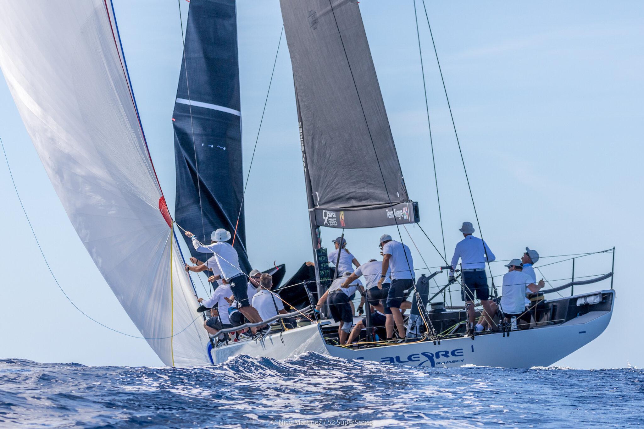 Allegre on a spinnaker reach, crew healing the boat to leeward.