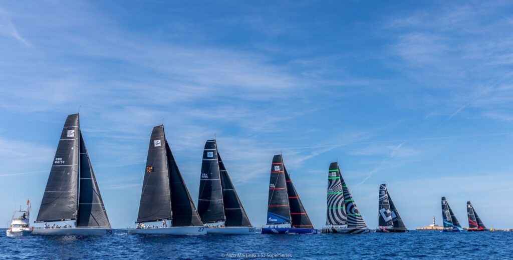 The fleet sailing upwind after the race start.