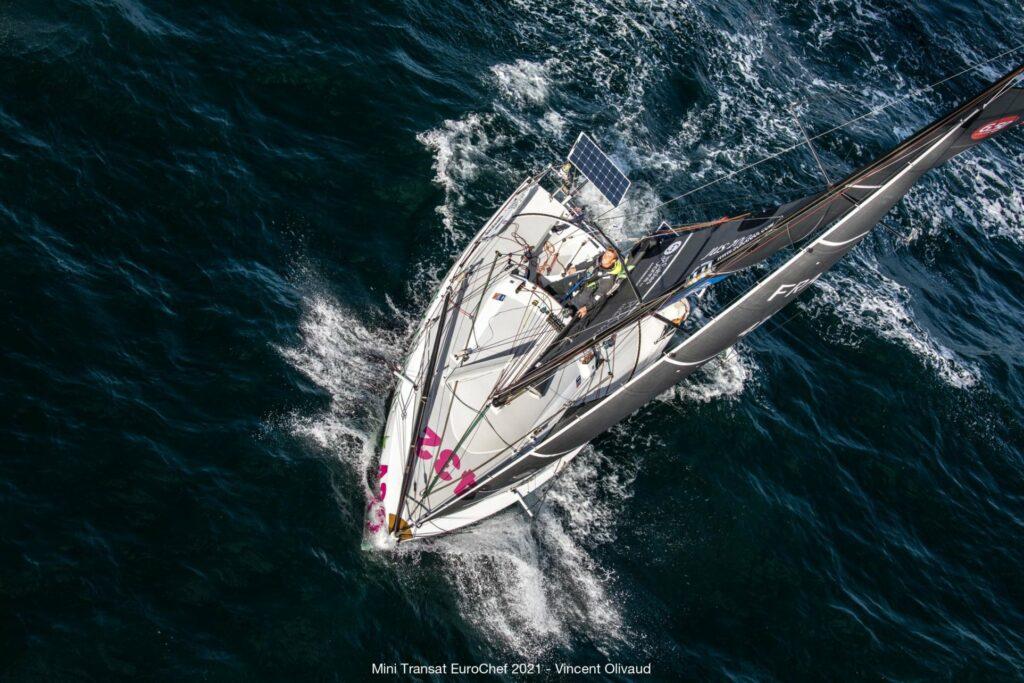Aerial shot of Tim Darni sailing on his boat.