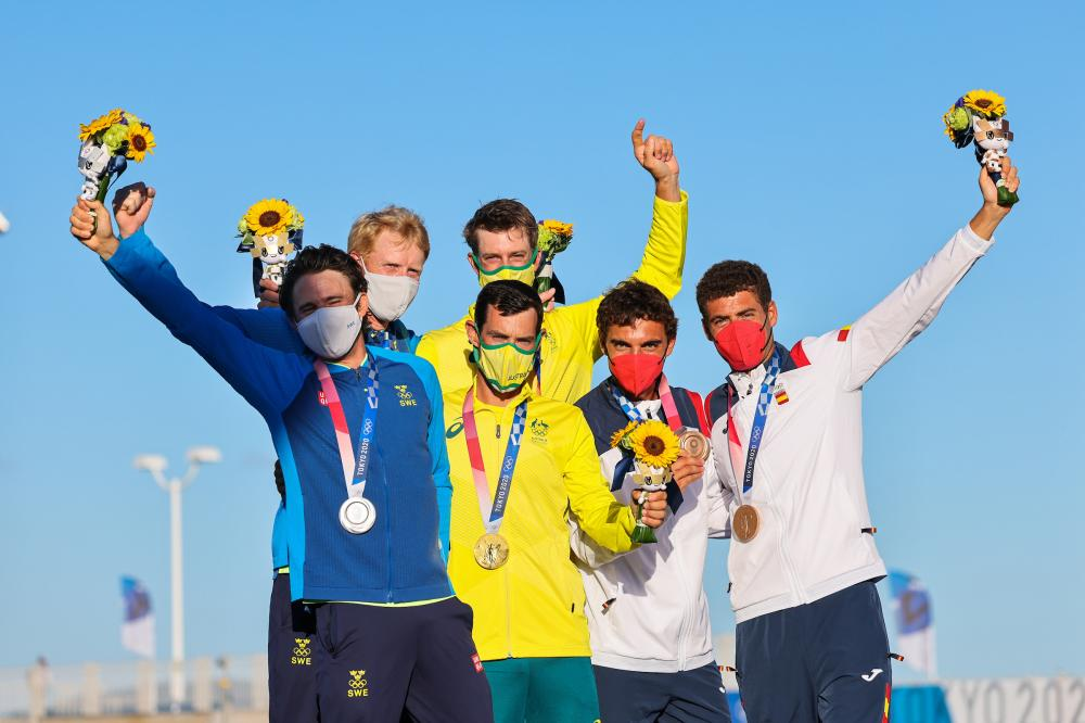 Sweden's Anton Dahlberg and Fredrik Bergstrom (silver), Mat Belcher and Will Ryan (gold) and Spain's Jordi Xammar and Nicolas Rodriguez Garcia-Paz (bronze) holding their medals at the awards ceremony.