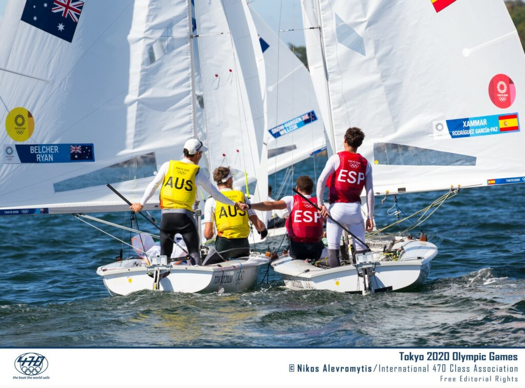 Mat and Will sailing downwind next to the Spanish team, congratulating each other.