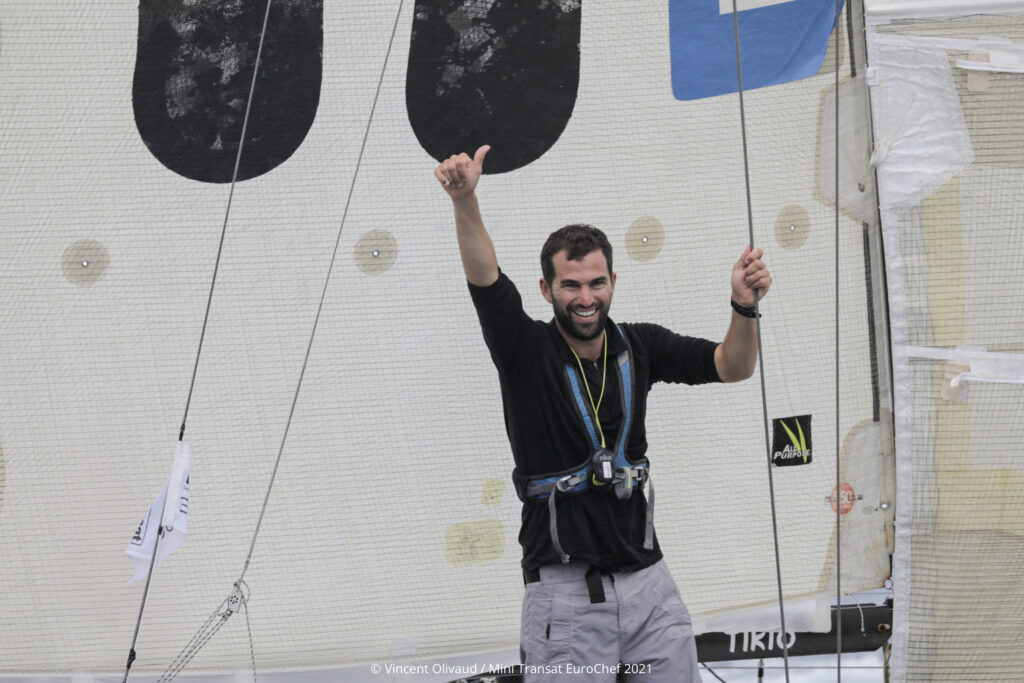 Tanguy Bouroullec celebrating his win on the boat.