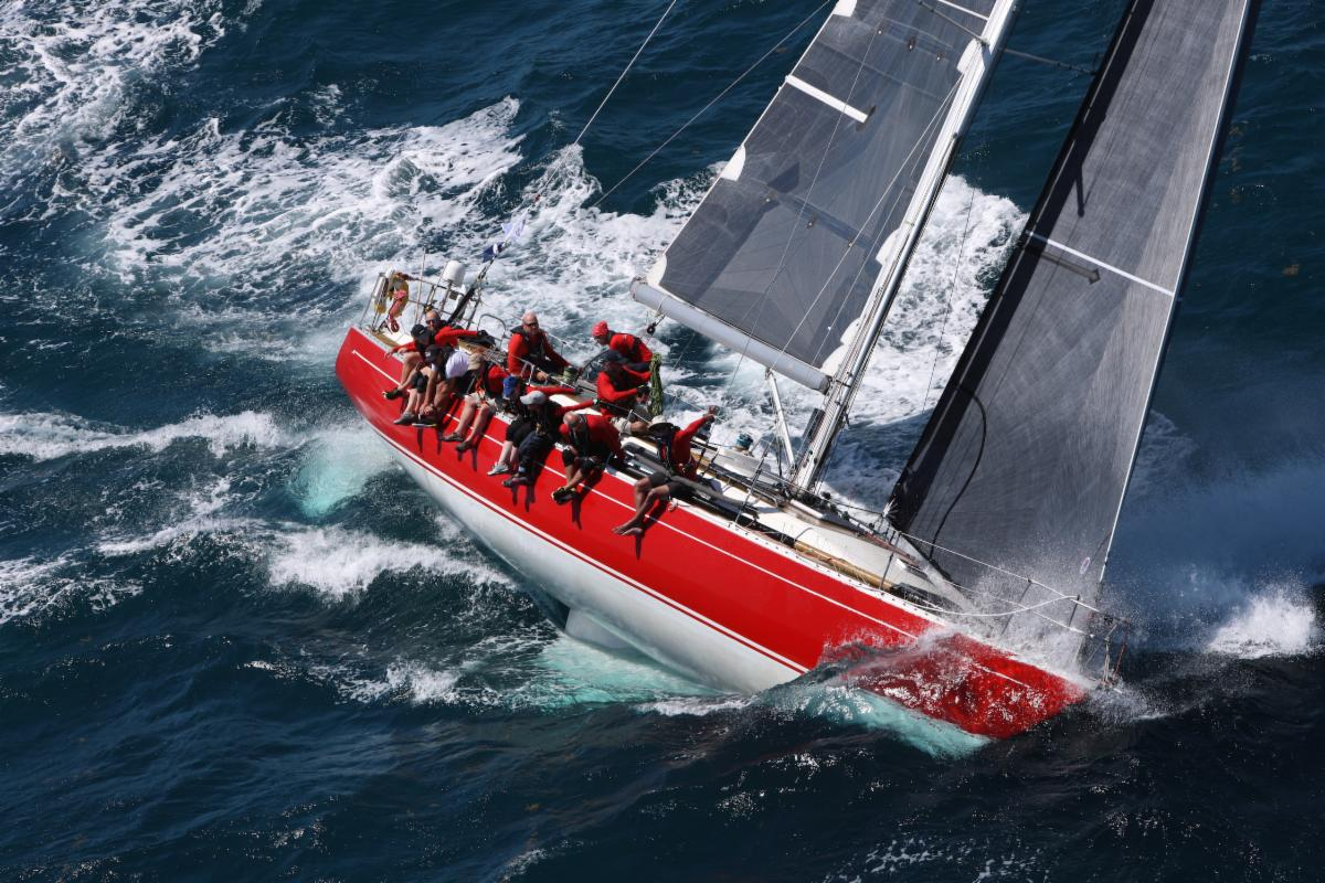 Aerial shot of Scarlet Oyster sailing upwind, healing over.