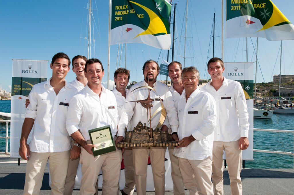The Artie III team holding a trophy on dock.