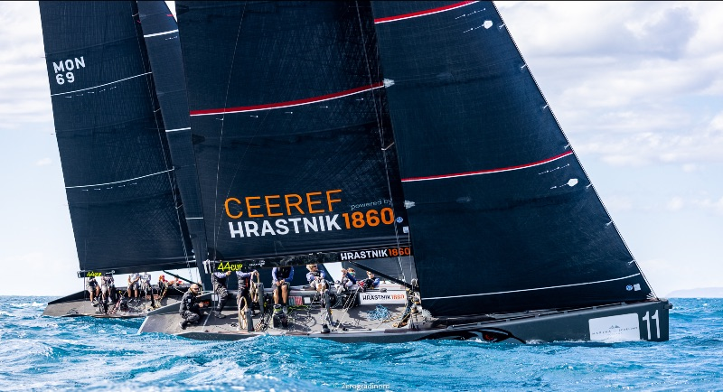 Ceeref sailing upwind, with another boat to its windward.