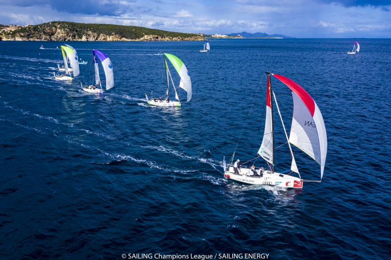 Aerial shot of fleet on a spinnaker reach, almost in a line.
