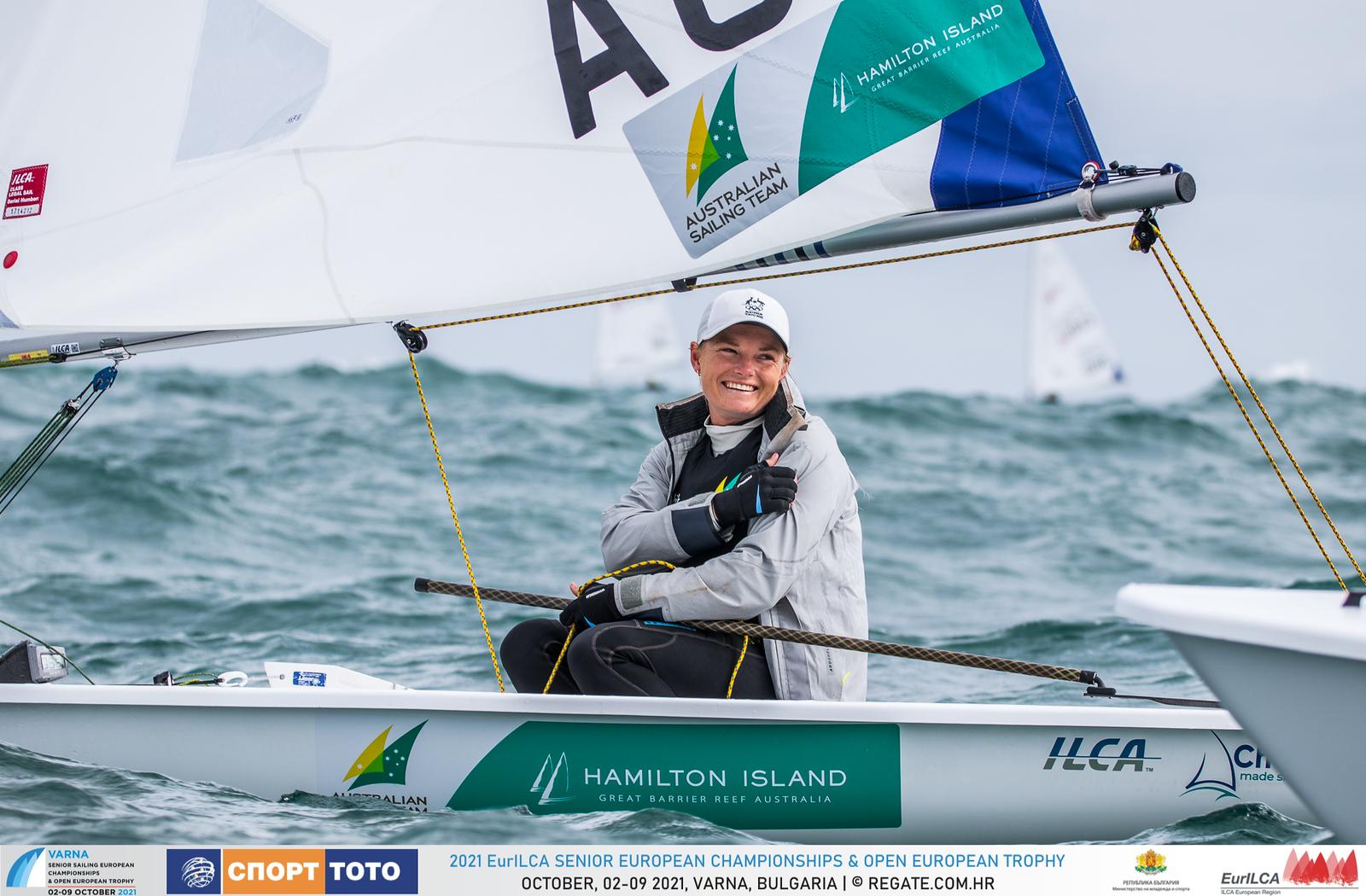 Mara Stransky on her boat smiling