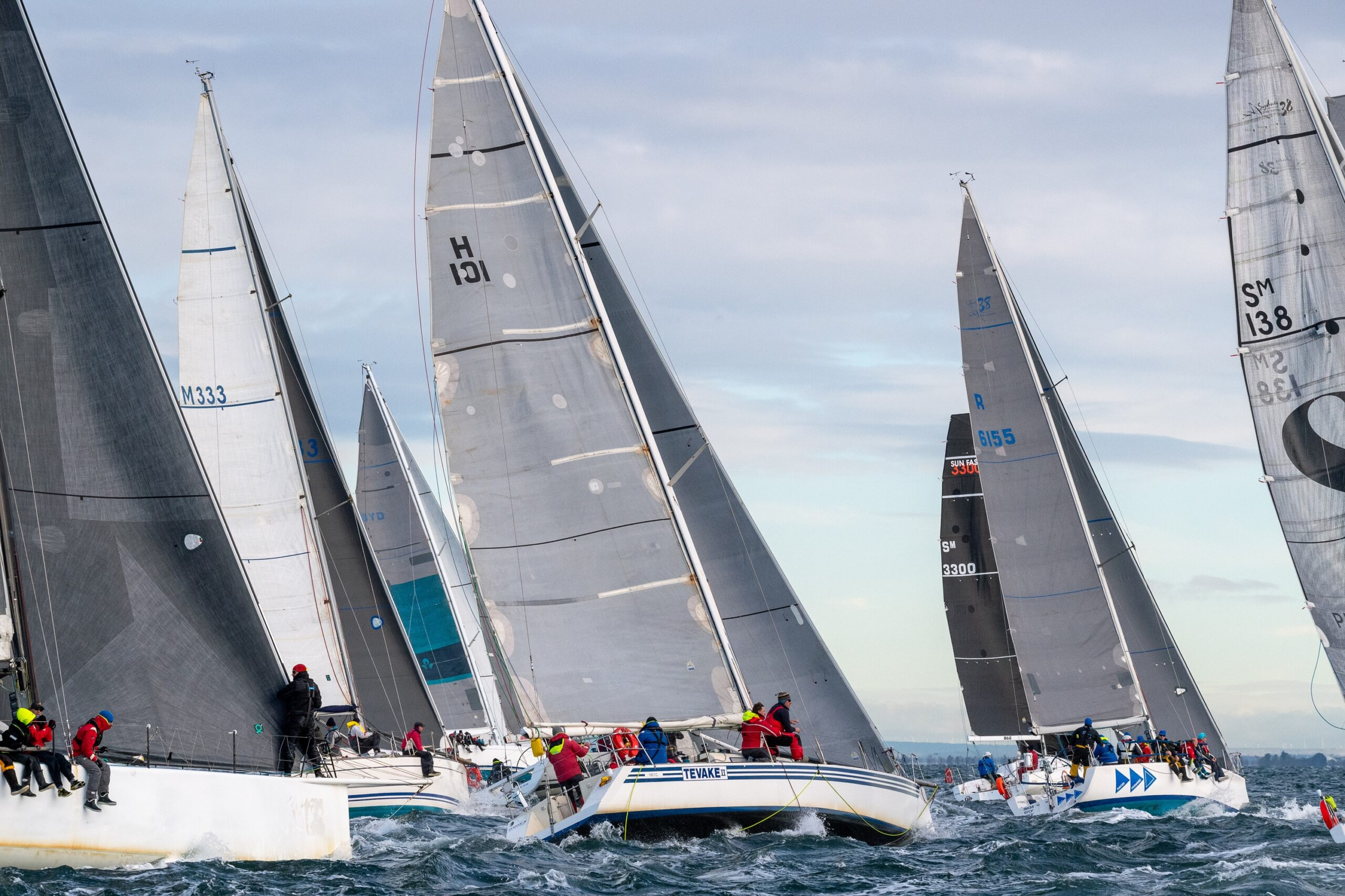 Yacht feet sailing upwind.