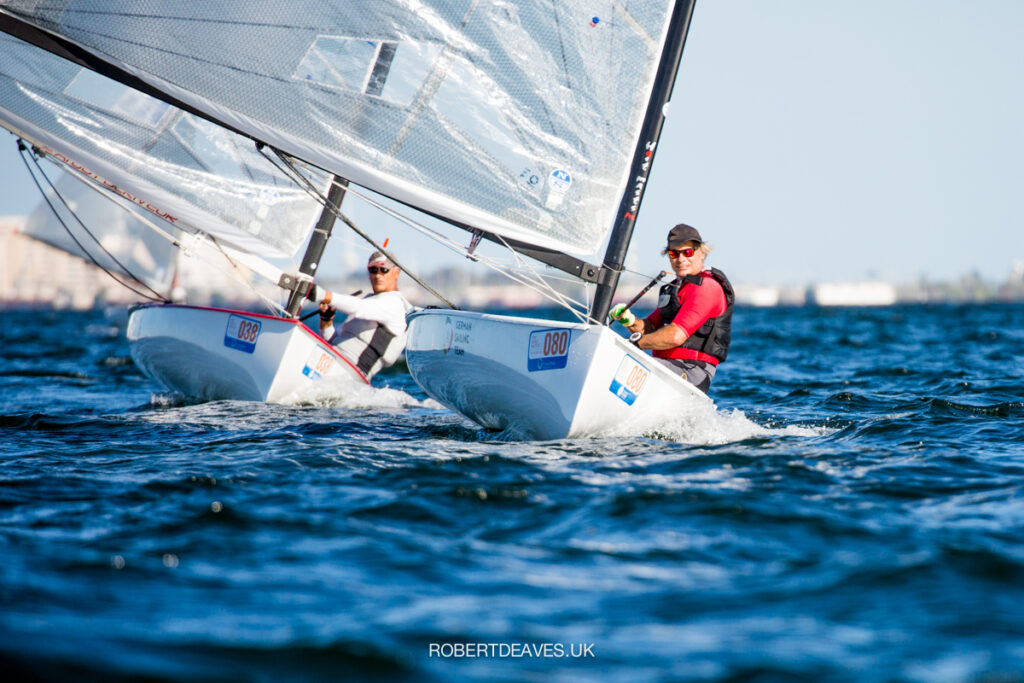 Andreas Gillwald sailing downwind ahead of Juan Grau Cases