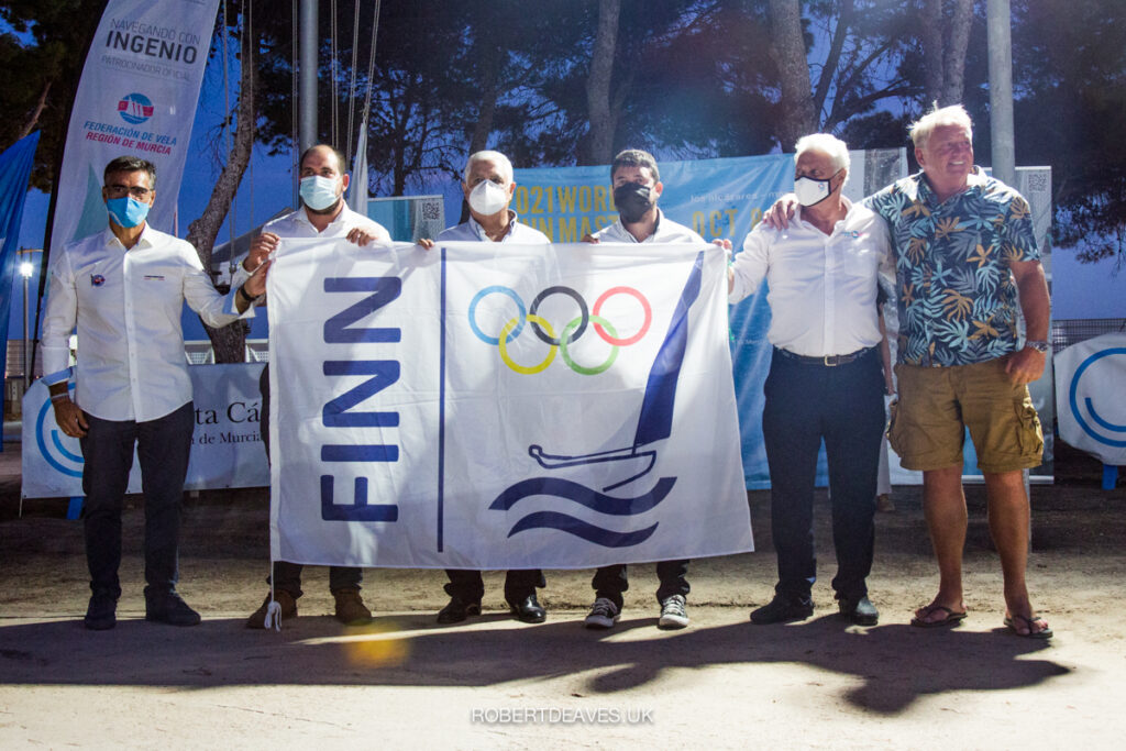 Six officials holding a Finn flag at the Opening Ceremony.