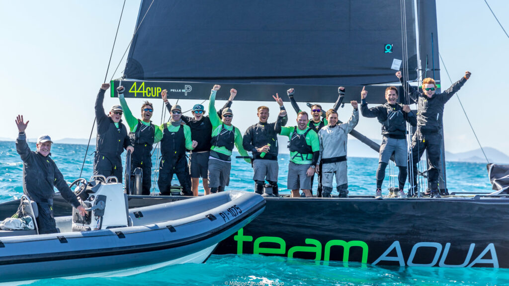 Team Aqua celebrating their win on the water.