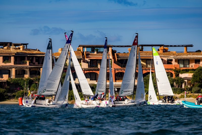 Fleet sailing upwind on different tacks.