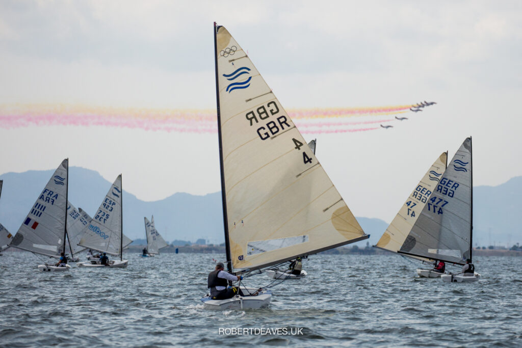 Fleet sailing downwind. Planes producing colours above.