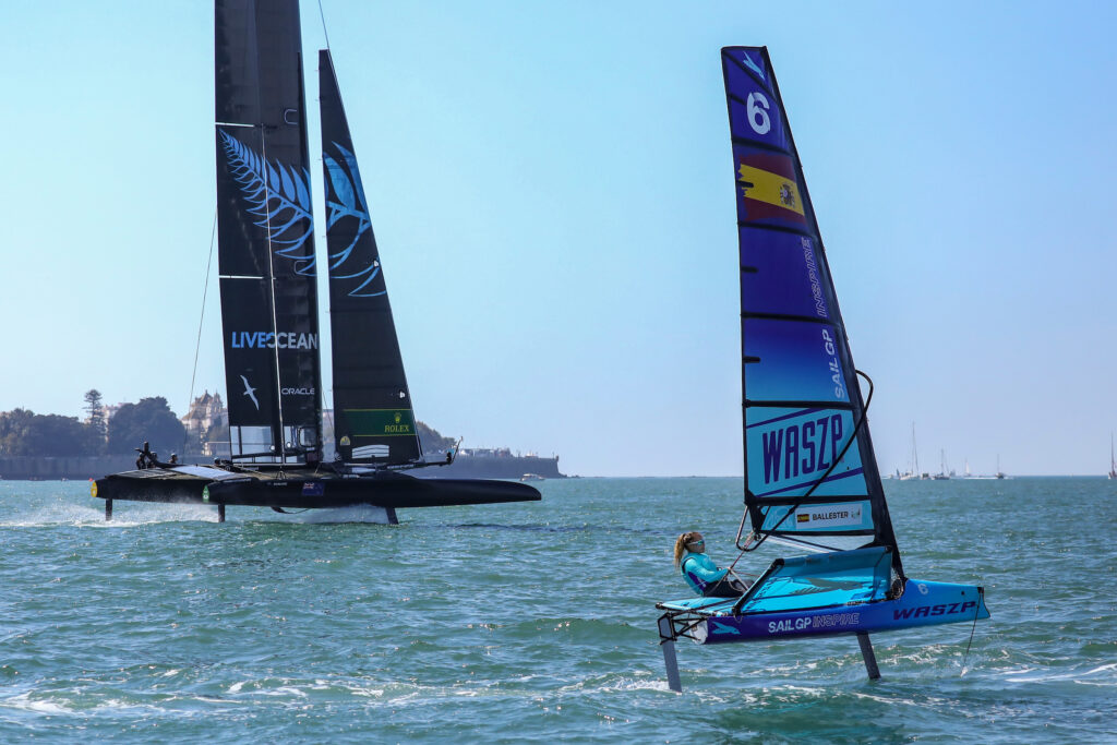 A waszp sailing with an f50 catamaran in the background.