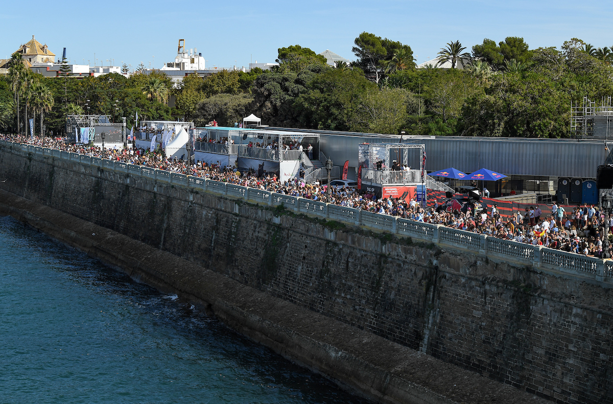 Crowds at the sea wall in Spain.
