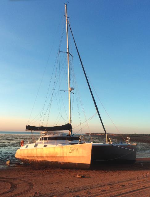Catamaran beached at sunset