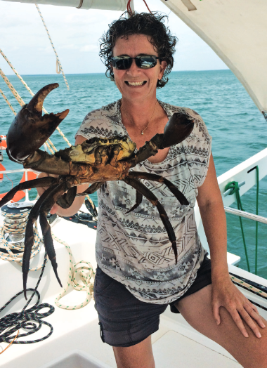 Justine holding a mud crab