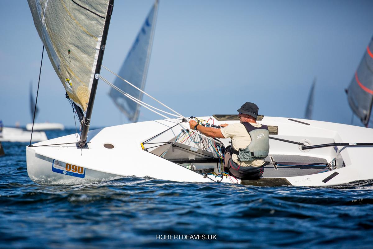 Karel van Hellemond sailing downwind, healing the boat to windward.