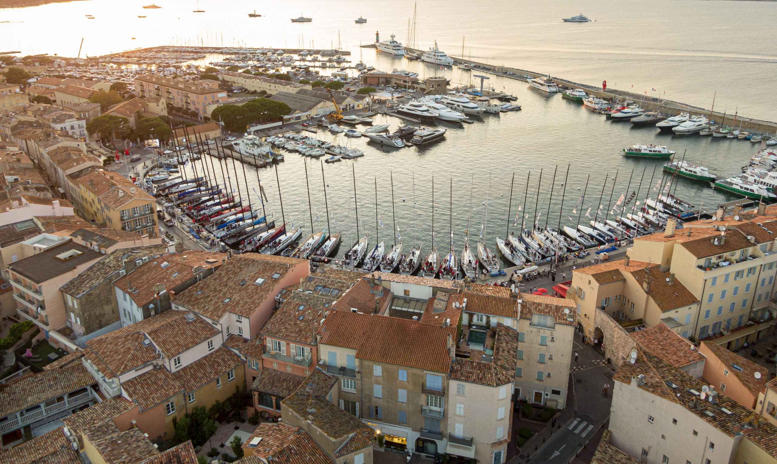 Aerial shot of St Tropez harbour, the boats at the dock.