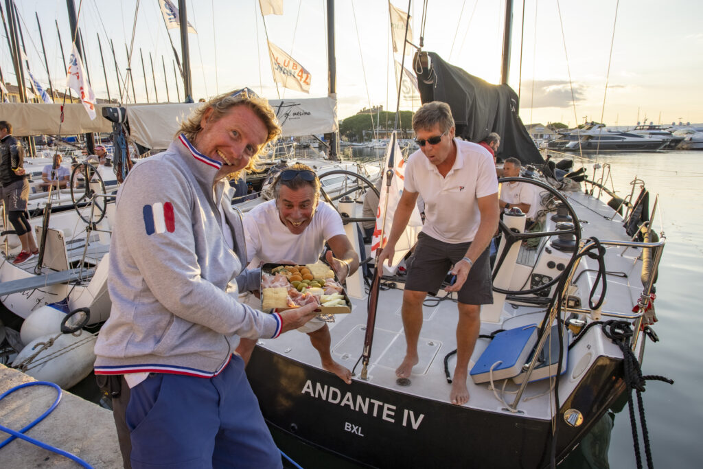 Sailors happy with champagne gift.