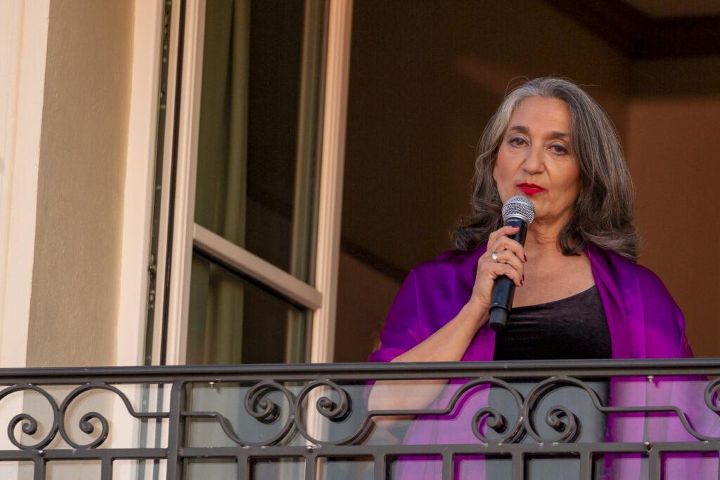 Singer on balcony