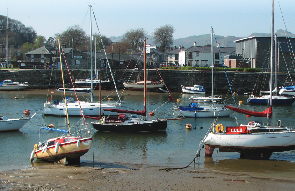 Boats moored at low tide. Some on the beach.