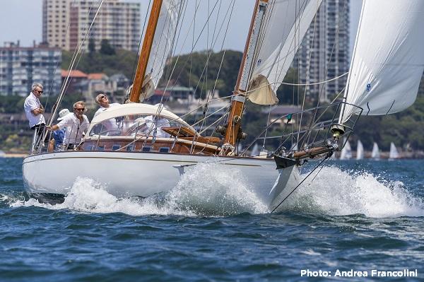 Yacht on a spinnaker reach in Sydney harbour.