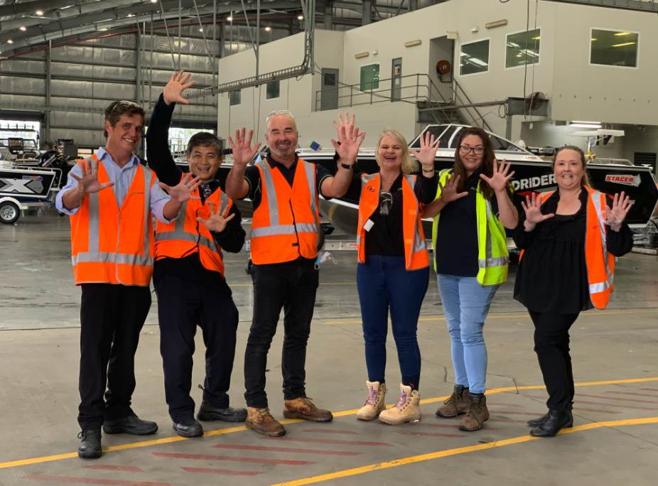 Suez and Telwater team in the factory, smiling.