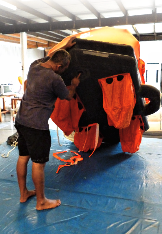 A person holding up a life raft.