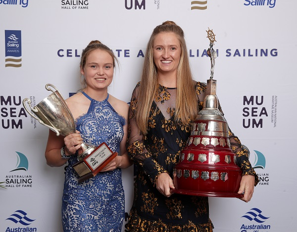 Nia Jerwood and Monique de Vries holding trophies at 2019 awards dinner.