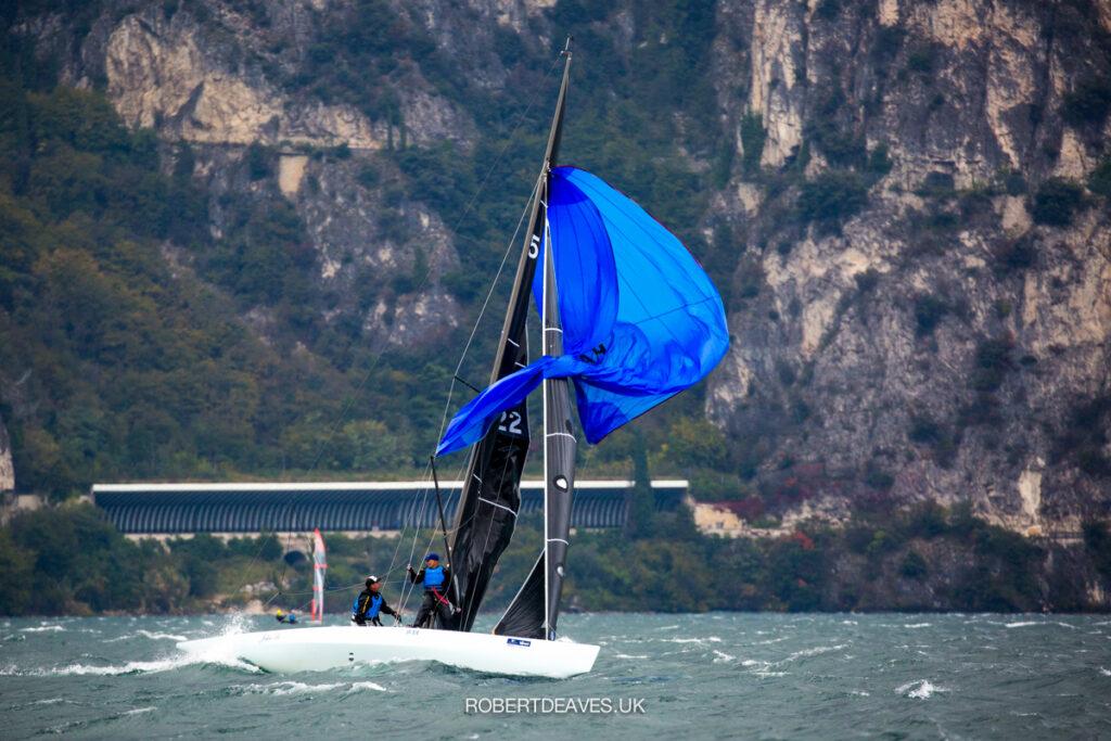 John B's blue kite flapping on the downwind.