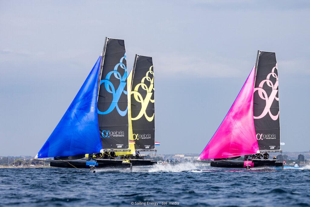 Three boats on a spinnaker reach.