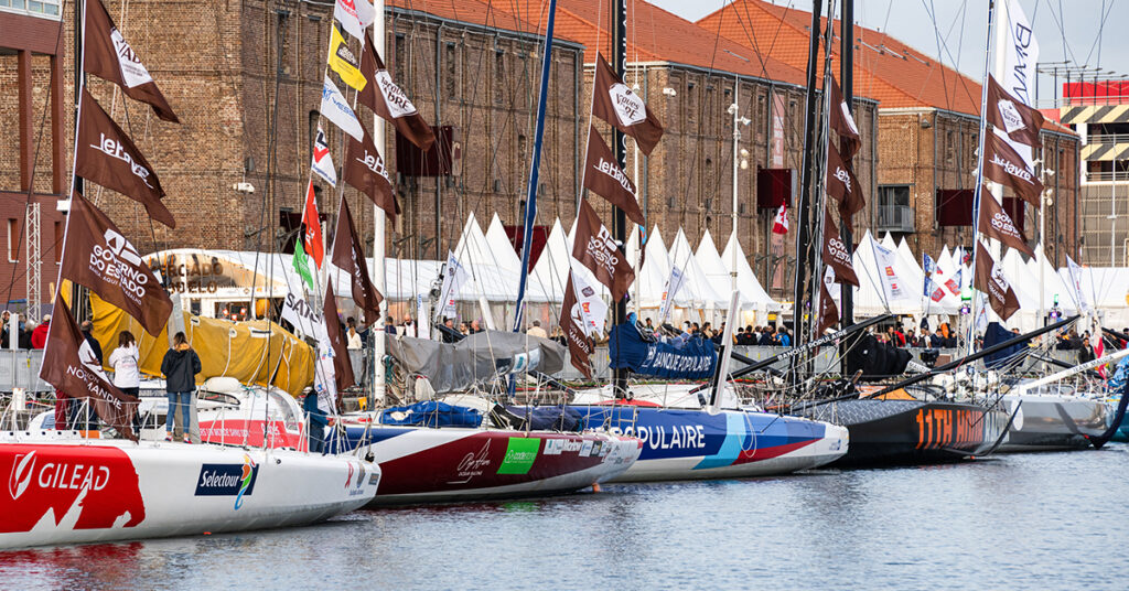 Boats lined up on dock at race village.